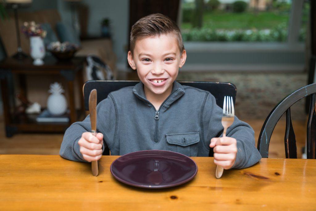 kid-boy-ready-for-dinner